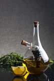 A glass cruet with olive oil and balsamic vinegar Royalty Free Stock Image