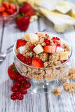 Glass with Crunchy Yoghurt and fresh fruits Royalty Free Stock Images