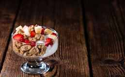 Glass with Crunchy Yoghurt and fresh fruits Royalty Free Stock Image