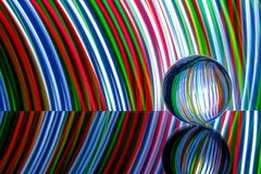 Glass sphere reflecting colorful light Royalty Free Stock Photo
