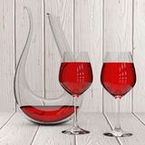 Glass Crystal Decanter with Red Wine and Two Wine Glasses. 3d Re. Glass Crystal Decanter with Red Wine and Two Wine Glasses on a wooden table. 3d Rendering Royalty Free Stock Photography