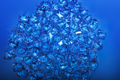 Glass crystals on the blue background Royalty Free Stock Photos