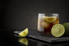 Glass of Cuba Libre Cocktail Stock Photo