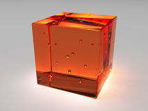 Glass cube. Red glass cube with bubbles Royalty Free Stock Image