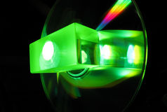 Glass cube in laser beam. Glass cube in a green laser beam stock photos