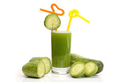 Glass of cucumber juice and slice of a cucumber Royalty Free Stock Photo