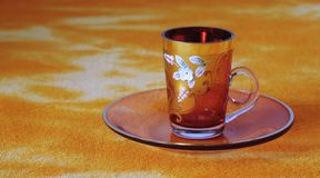 Glass cup. Decorated with flowers Royalty Free Stock Photos