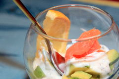 Glass cup with avocado and salmon Stock Photo