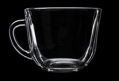 Glass cup on black Royalty Free Stock Photography