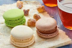 Glass cup of black tea and colorful macaroons Stock Photo