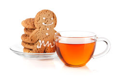 Glass cup of black tea with homemade cookies and gingerbread man Stock Image
