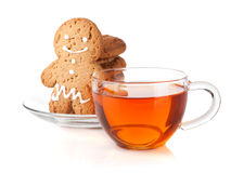 Glass cup of black tea with homemade cookies and gingerbread man Royalty Free Stock Photography