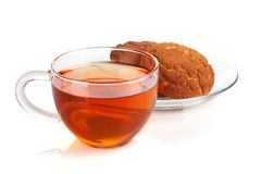 Glass cup of black tea with homemade cookies Stock Image