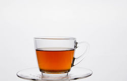 Glass cup of black tea. Isolated on white background Royalty Free Stock Photography