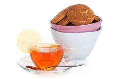 Glass cup of black tea with lemon and cookies Royalty Free Stock Image