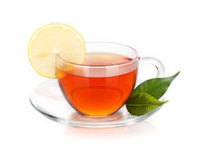Glass cup of black tea with lemon slice Royalty Free Stock Image