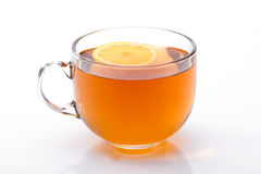 Glass cup of black tea with lemon Royalty Free Stock Photography
