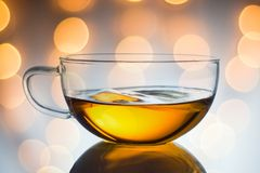 Glass cup of black tea. on light background Royalty Free Stock Photos