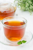 Glass cup of black tea with mint closeup Royalty Free Stock Photo