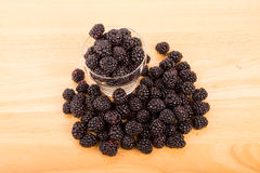 Glass Cup of Blackberries on a Wood Table Royalty Free Stock Photography
