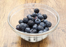 A glass cup of blueberries Stock Image