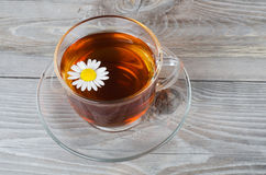 Glass cup with a camomile tea Stock Photography