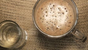 Glass cup of cappuccino and a glass of water stock video