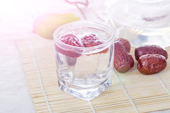 A glass cup of Chinese red date tea on the table. Stock Images