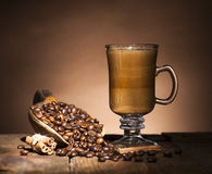 Glass cup with coffee beans Royalty Free Stock Photography