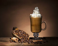 Glass cup with coffee beans Royalty Free Stock Photos