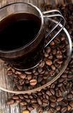 Glass cup of coffee with coffee beans Royalty Free Stock Images