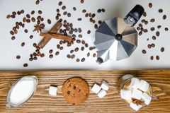 Glass cup of coffee, coffee maker and dessert. Top view stock images