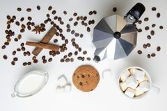 Glass cup of coffee, coffee maker and dessert. Top view. Glass cup of coffee, coffee maker and dessert stock photo