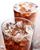 Glass cup of cola soda with ice. Two glass cups of cola soda with ice shot with selective focus Stock Photos