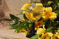 Glass cup with drink and flowers Royalty Free Stock Photo