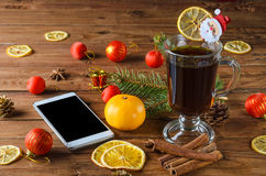 Glass cup with drink and smartphone on a wooden table, the Chris Royalty Free Stock Image