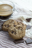 Glass cup of espresso with two cookies with dark chocolate Stock Photography
