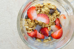 Glass cup filled with granola, strawberry and chocolate drops Stock Images