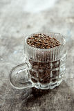 Glass cup  with flax seed Royalty Free Stock Image