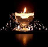 Glass cup with floating candle Royalty Free Stock Photography