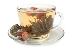 Glass cup with flowering tea. On white background royalty free stock images