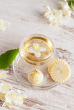 Glass cup of green tea with jasmine and white chocolate Royalty Free Stock Image