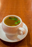 Glass cup with green tea and mint Stock Photo