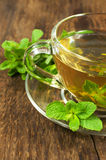 Glass cup with green tea and mint Royalty Free Stock Image