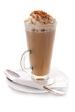Glass cup of hot coffee with cream and cinnamon. A transparent glass cup of hot coffee with cream and cinnamon on a white background, forforovoe saucer, napkin Royalty Free Stock Photo