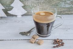 Glass cup of hot coffee on rustic background Royalty Free Stock Image