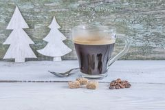 Glass cup of hot coffee on rustic background Stock Image