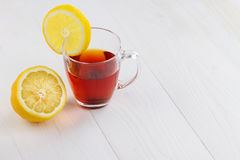Glass cup of hot tea and a lemon Royalty Free Stock Photos