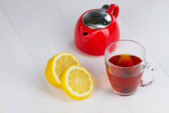 Glass cup of hot tea and a lemon Royalty Free Stock Photography