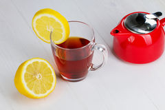 Glass cup of hot tea and a lemon Stock Photography